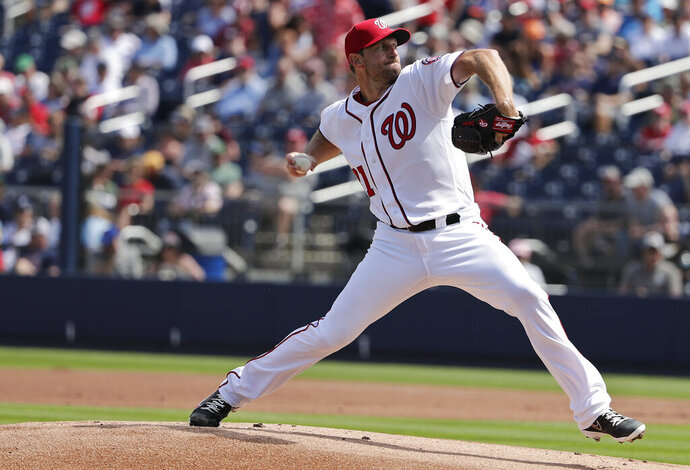 Washington Nationals starting pitcher Max Scherzer (31) throws in the first inning of an exhibition spring training baseball game against the Boston Red Sox, Tuesday, March 5, 2019, in West Palm Beach. (AP Photo/Brynn Anderson)