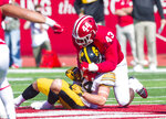 Indiana linebacker Dameon Willis Jr. (43) tackles Iowa wide receiver Nick Easley (84) during the second half of an NCAA college football game Saturday, Oct. 13, 2018, in Bloomington, Ind. Iowa won 42-16. (AP Photo/Doug McSchooler)