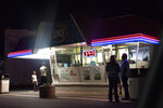 Customers wait in line at a Dairy Queen on a warm evening in Palatka, Fla., Wednesday, April 14, 2021. The town has a population split almost equally between Black and white. (AP Photo/David Goldman)