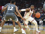 Oklahoma guard De'Vion Harmon (11) pushes past Mississippi State guard Robert Woodard (12) during the first half of an NCAA college basketball game in Oklahoma City, Saturday, Jan. 25, 2020. (AP Photo/Kyle Phillips)
