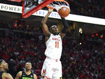 FILE - Maryland guard Darryl Morsell (11) goes to the basket for a slam dunk during the second half of an NCAA college basketball game against Michigan State in College Park, Md., in this Saturday, Feb. 29, 2020, file photo. (AP Photo/Terrance Williams, File)