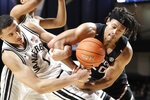 Vanderbilt's Dylan Disu (1) and South Carolina's Alanzo Frink (20) get tangled fighting for the ball in the second half of an NCAA college basketball game Saturday, March 7, 2020, in Nashville, Tenn. (AP Photo/Mark Humphrey)
