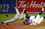 Baltimore Orioles' Richie Martin (1) is tagged out at second base by Toronto Blue Jays shortstop Freddy Galvis (16) during fourth-inning baseball game action in Toronto, Monday, April 1, 2019. (Nathan Denette/The Canadian Press via AP)