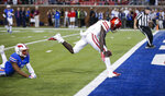 Houston wide receiver Marquez Stevenson (5) scores a touchdown in front of SMU defensive back Rodney Clemons during the first half of an NCAA college football game Saturday, Nov. 3, 2018, in Dallas. (AP Photo/Brandon Wade)