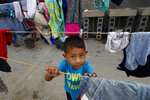 A migrant child plays at the AMAR migrant shelter in Nuevo Laredo, Mexico, Wednesday, July 17, 2019. A U.S. policy to make asylum seekers wait in Mexico while their cases wind through clogged U.S. immigration courts has also expanded to the violent city of Nuevo Laredo. (AP Photo/Marco Ugarte)