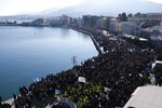 Protesters take part in a rally in the port of Mytilene, on the northeastern Aegean island of Lesbos, Greece, on Wednesday, Jan. 22, 2020. Local residents and business owners have launched a day of protest on the Greek islands hardest hit by migration, demanding the Greek government ease severe overcrowding at refugee camps. (AP Photo/Aggelos Barai)