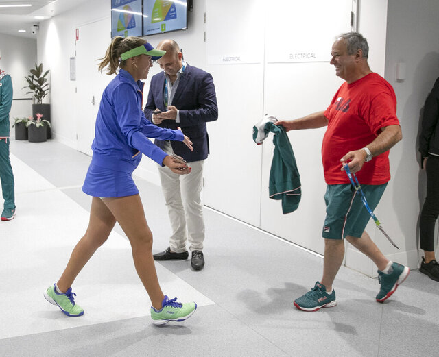 In this photo provided by Tennis Australia, Sofia Kenin, left, of the U.S. is greeted by her father Alex after defeating Spain's Garbine Muguruza in the women's final at the Australian Open tennis championship in Melbourne, Australia, Saturday, Feb. 1, 2020. (Fiona Hamilton/Tennis Australia via AP)