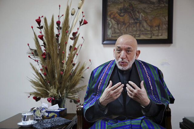 Former Afghan President Hamid Karzai speaks during an interview with The Associated Press, in Kabul, Afghanistan, Tuesday, Dec. 10, 2019. Karzai, whose final years in power were characterized by a cantankerous relationship with the United States, said on Tuesday that Washington used blackmail and corruption to manipulate his officials, undermine his government and foment violence among the country's many factions. (AP Photo/Altaf Qadri)