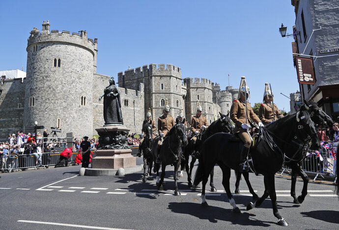 Mounted soldiers parade during a rehearsal for the procession of the upcoming wedding of Britain's Prince Harry and Meghan Markle in Windsor, England, Thursday, May 17, 2018. Preparations are being made in the town ahead of the wedding of Britain's Prince Harry and Meghan Markle that will take place in Windsor on Saturday May 19.(AP Photo/Frank Augstein)