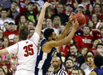 Penn State's Josh Reaves, right, grabs a defensive rebound against Wisconsin's Nate Reuvers (35) during the first half of an NCAA college basketball game Saturday, March 2, 2019, in Madison, Wis. (AP Photo/Andy Manis)
