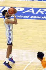 Kentucky's Olivier Sarr, left, shoots near Tennessee's Corey Walker Jr., during the second half of an NCAA college basketball game in Lexington, Ky., Saturday, Feb. 6, 2021. (AP Photo/James Crisp)