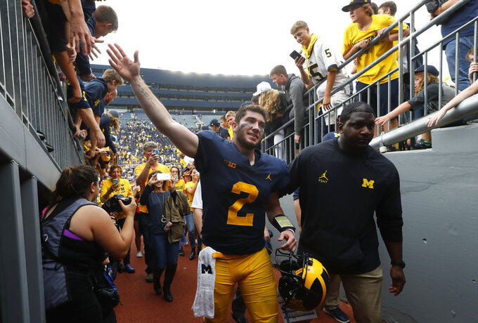 Michigan quarterback Shea Patterson (2) leaves the field after beating Maryland 42-21 after an NCAA football game in Ann Arbor, Mich., Saturday, Oct. 6, 2018. (AP Photo/Paul Sancya)