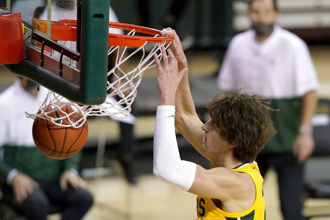 Baylor guard Matthew Mayer dunks during the second half of the team's NCAA college basketball game against Stephen F. Austin in Waco, Texas, Wednesday, Dec. 9, 2020. (AP Photo/Tony Gutierrez)