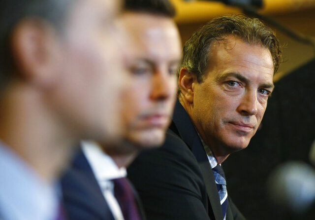 FILE - Colorado Avalanche general manager Joe Sakic, right, looks on during a news conference to introduce Jared Bednar as the NHL hockey club's new coach in Denver, in this Wednesday, Aug. 31, 2016, file photo. Sakic announced on Tuesday, Jan. 12, 2021, that a ceremony is planned before the start of the team's regular-season opener against St. Louis on Wednesday to honor Pierre Lacroix, the team's retired president, who died from COVID-19 complications last month in Las Vegas. (AP Photo/David Zalubowski, File)