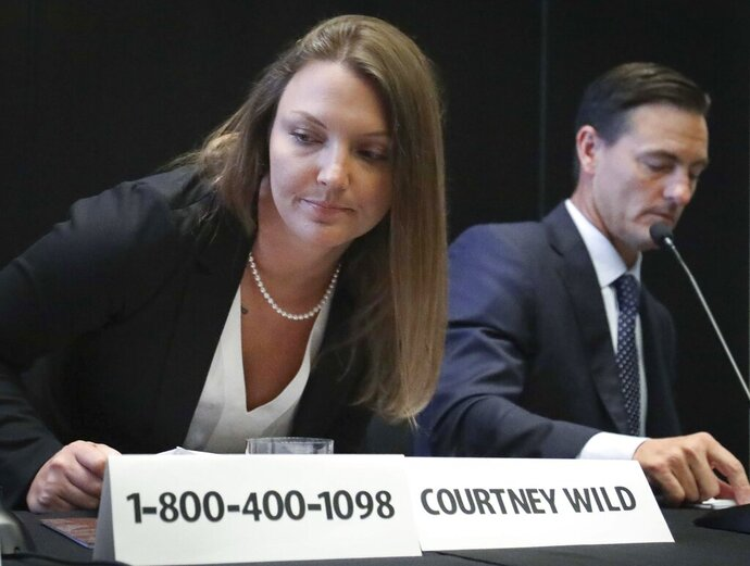 Courtney Wild, left, joined by her attorney Brad Edwards, leaves after reading a statement a news conference, calling on victims of Jeffrey Epstein to contact the FBI or lawyers with their information, Tuesday, July 16, 2019, in New York. (AP Photo/Bebeto Matthews)