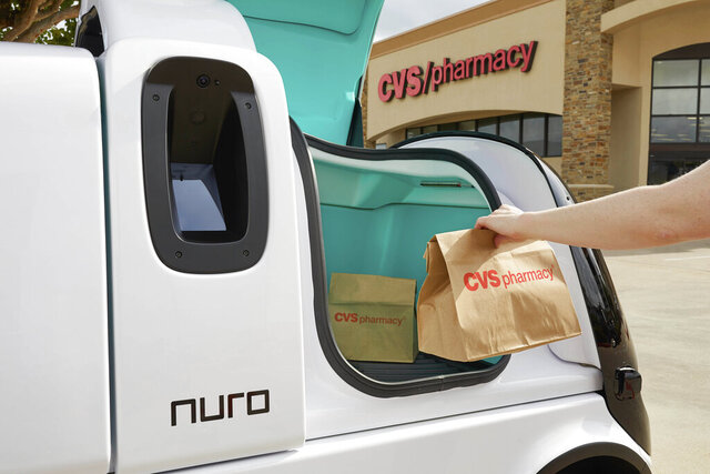 This undated photo provided by Nuro shows a package delivered to a Nuro vehicle. CVS Health said Thursday, May 28, 2020 it will partner with Silicon Valley robotics company Nuro on deliveries of medicines and other products to customers near a Houston-area store/ (Nathan Lindstrom/Nuro via AP)