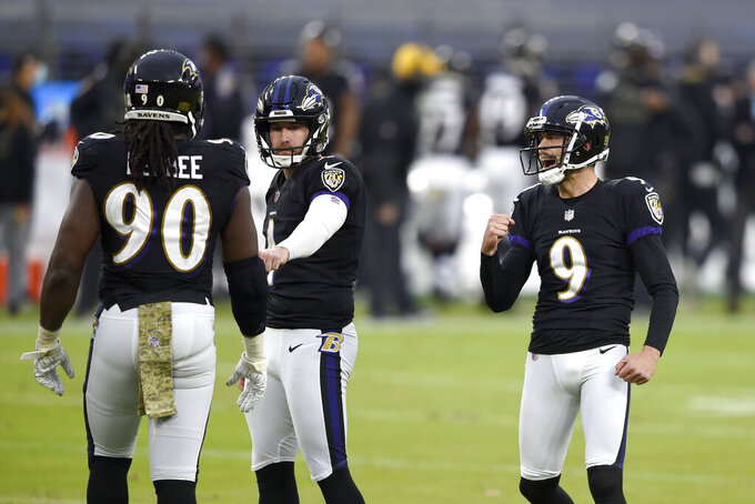Baltimore Ravens kicker Justin Tucker reacts after kicking a field goal during the second half of an NFL football game against the Tennessee Titans, Sunday, Nov. 22, 2020, in Baltimore. The Titans won 30-24 in overtime. (AP Photo/Gail Burton)