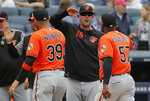 FILE - In this Saturday, March 30, 2019 file photo,Baltimore Orioles manager Brandon Hyde (18) congratulates players after they defeated the New York Yankees in a baseball game in New York. The win was Hyde's first as a major league manager. There might come a time when Brandon Hyde wakes up in the morning, grabs a newspaper and checks out the standings to see where the Baltimore Orioles stand. For now, the rookie manager simply can't bear to look. The rebuilding Orioles limped into the All-Star break with a major league worst 27-62 record. (AP Photo/Julie Jacobson, File)