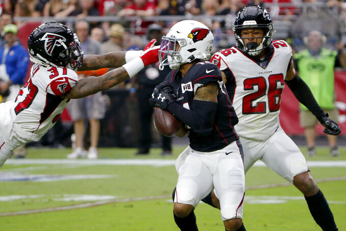 Arizona Cardinals wide receiver Damiere Byrd, center, pulls in a catch as Atlanta Falcons free safety Ricardo Allen (37) defends during the first half of an NFL football game, Sunday, Oct. 13, 2019, in Glendale, Ariz. (AP Photo/Rick Scuteri)
