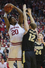Indiana forward De'Ron Davis (20) shoots over Purdue forward Evan Boudreaux (12) during the second half of an NCAA college basketball game in Bloomington, Ind., Tuesday, Feb. 19, 2019. Purdue won 48-46. (AP Photo/AJ Mast)
