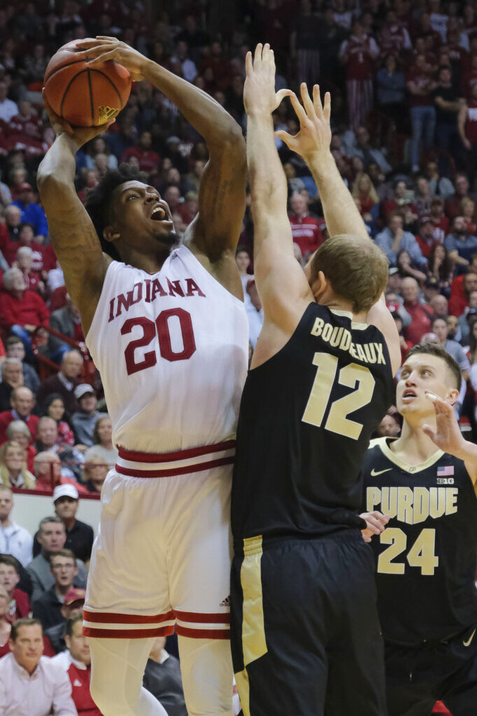 Indiana forward De'Ron Davis (20) shoots over Purdue forward Evan Boudreaux (12) during the second half of an NCAA college basketball game in Bloomington, Ind., Tuesday, Feb. 19, 2019. Purdue won 48-46. (AP Photo/AJ Mast)