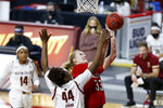 NC State's Elissa Cunane (33) drives to the basket against Boston College's Akunna Konkwo (44) during the first half of an NCAA college basketball game, Sunday, Dec. 13, 2020, in Boston. (AP Photo/Mary Schwalm)