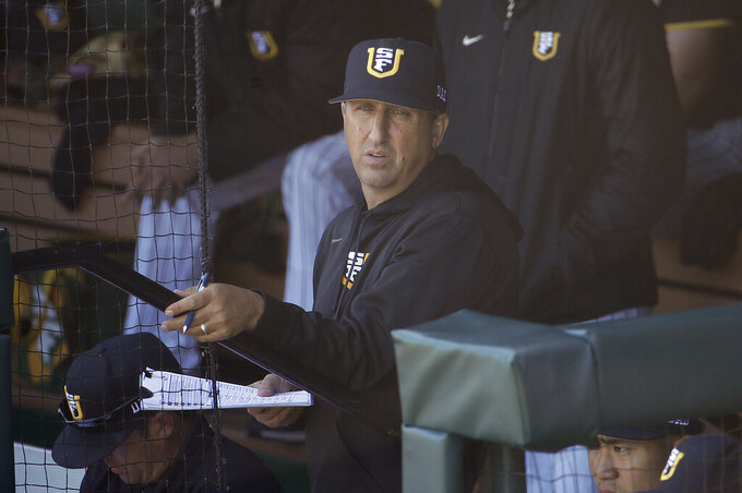"""FILE - In this April 9, 2019, file photo, San Francisco head coach Nino Giarratano watches action against Stanford during an NCAA college baseball game in San Francisco. As thousands of college athletes and coaches across the country try to adjust after the sudden suspensions of entire seasons of competition and perhaps more so the camaraderie of daily practices, training sessions and team meals, communication specialists and mental health professionals are encouraging those involved to allow these young men and women to go through the stages of grieving as needed. """"It is very similar to grieving,"""" said Giarratano. """"We are in contact daily trying to help them academically, athletically and keeping their spirits up."""" (AP Photo/Jeff Chiu, File)"""