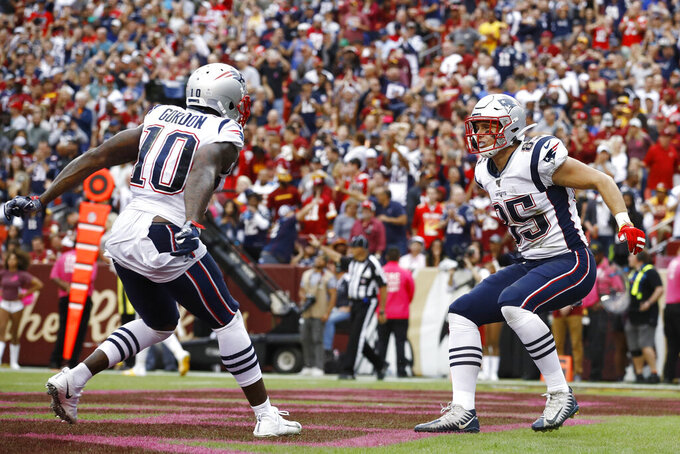 New England Patriots tight end Ryan Izzo (85)celebrates a touchdown catch against the Washington Redskins during the second half of an NFL football game, Sunday, Oct. 6, 2019, in Washington. (AP Photo/Patrick Semansky)