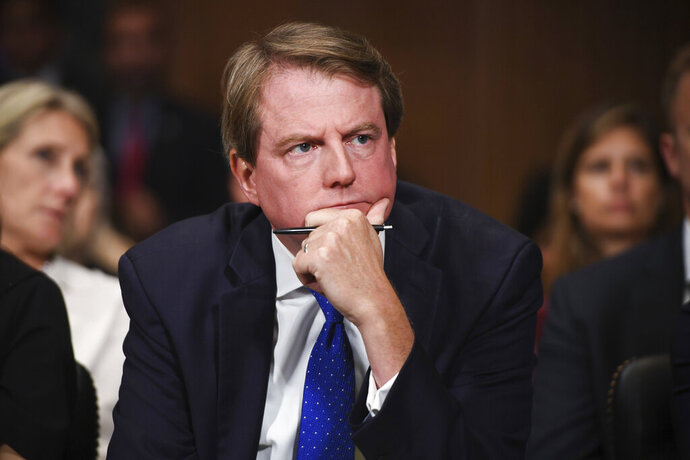 FILE - In this Sept. 27, 2018, file photo, then-White House counsel Don McGahn listens as Supreme court nominee Brett Kavanaugh testifies before the Senate Judiciary Committee on Capitol Hill in Washington. House Speaker Nancy Pelosi says the House Judiciary Committee will file a lawsuit in federal court on aug. 7, 2019, aimed at forcing McGahn to testify about his interactions with President Donald Trump.  (Saul Loeb/Pool Photo via AP, File)