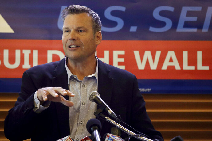 FILE- In this July 8, 2019 file photo, former Kansas Secretary of State Kris Kobach addresses the crowd as he announces his candidacy for the Republican nomination for the U.S. Senate in Leavenworth, Kan. Secretary of State Mike Pompeo said Tuesday, Jan. 7, 2020, that he'll remain in his post as the country's top diplomat, forgoing a run for Senate from Kansas that many Republicans have seen as the party's best hope of retaining what should be a guaranteed GOP seat from the deep red state. Without him, Washington Republicans worry that Kobach, a polarizing conservative who lost a race for governor last year, would become the GOP's Senate candidate and lose in the general election.  (AP Photo/Charlie Riedel, File)