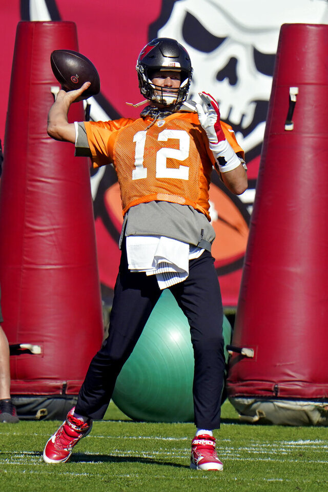 Tampa Bay Buccaneers quarterback Tom Brady (12) throws a pass during an NFL football practice Wednesday, Jan. 6, 2021, in Tampa, Fla. The Buccaneers play the Washington Football Team in a playoff game Saturday night. (AP Photo/Chris O'Meara)