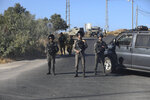 Israeli troops secure the area where a body of a soldier with stab wounds was found near Gush Etzion settlement in the West Bank, Thursday, Aug, 8, 2019. (AP Photo/Mahmoud Illean)