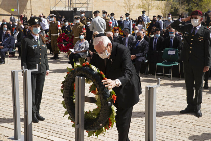 Israeli President Reuvin Rivlin lays a wreath at a ceremony marking the annual Holocaust Remembrance Day, at Yad Vashem Holocaust Memorial in Jerusalem, Thursday, April 8, 2021. (AP Photo/Maya Alleruzzo, Pool)