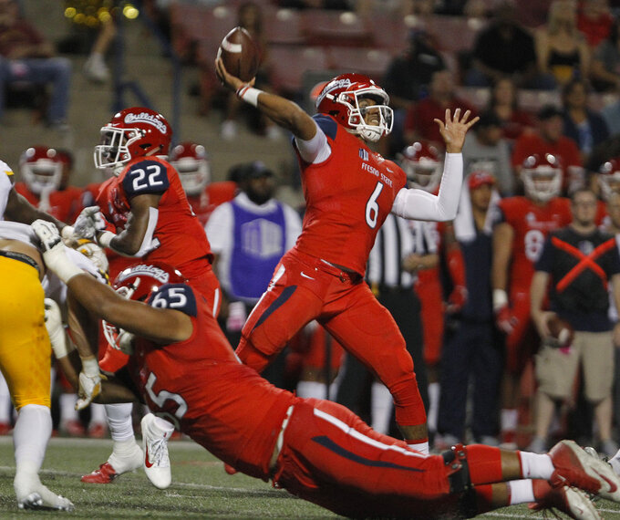 Fresno State quarterback Marcus McMaryion throws a pass against Wyoming during the first half of an NCAA college football game in Fresno, Calif., Saturday, Oct. 13, 2018. (AP Photo/Gary Kazanjian)