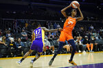 Los Angeles Sparks guard Erica Wheeler (17) defends against Connecticut Sun forward DeWanna Bonner (24) during the first half of WNBA basketball game Thursday, Sept. 9, 2021, in Los Angeles. (AP Photo/Ashley Landis)