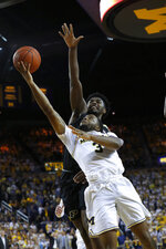 Michigan guard Zavier Simpson (3) shoots in front of Purdue forward Trevion Williams during the second half of an NCAA college basketball game in Ann Arbor, Mich., Thursday, Jan. 9, 2020. (AP Photo/Paul Sancya)