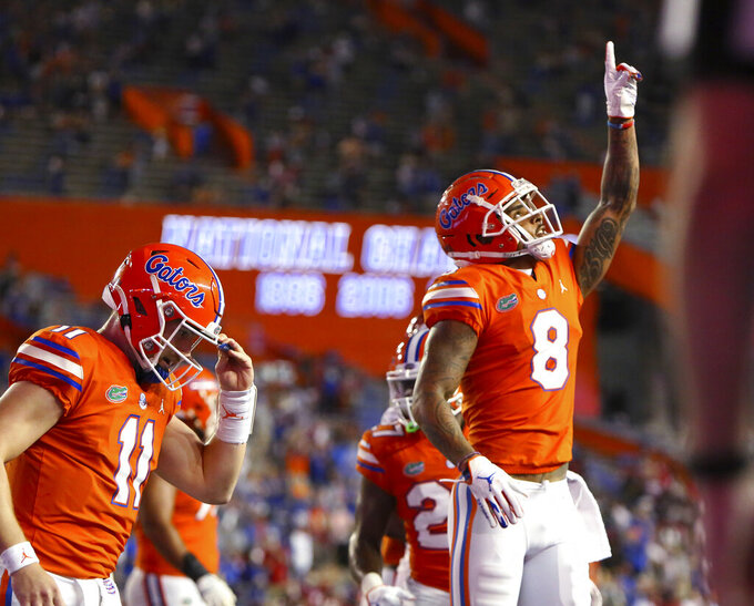 Florida receiver Trevon Grimes (8) celebrates after a touchdown reception against Arkansas during an NCAA college football game in Gainesville, Fla., Saturday, Nov. 14, 2020. [Brad McClenny/The Gainesville Sun via AP)
