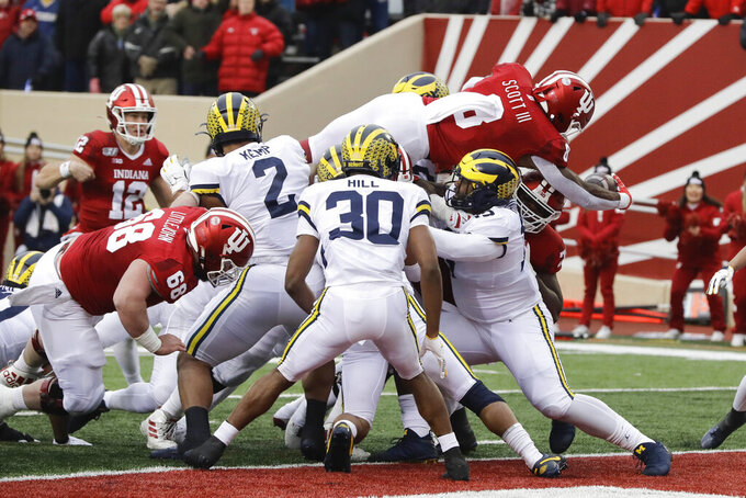 Indiana running back Stevie Scott III (8) goes in for a touchdown during the first half of an NCAA college football game against Michigan, Saturday, Nov. 23, 2019, in Bloomington, Ind. (AP Photo/Darron Cummings)