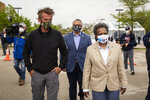 From left, actor and activist Sean Penn, Ald. Gilbert Villegas (36th) and Chicago Mayor Lori Lightfoot tour the new coronavirus drive-thru testing site at Dr. Jorge Prieto Math and Science Academy, in Chicago, organized by the CORE disaster relief organization started by Penn, Monday, May 18, 2020.(Ashlee Rezin Garcia/Chicago Sun-Times via AP)