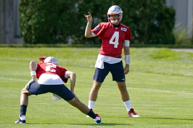 New England Patriots quarterbacks Brian Hoyer, left, and Jarrett Stidham speak during an NFL football training camp practice, Wednesday, Aug. 19, 2020, in Foxborough, Mass. (AP Photo/Steven Senne, Pool)