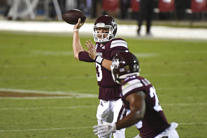 Mississippi State quarterback K.J. Costello (3) looks to throw the ball during the first half of the team's NCAA college football game against Arkansas in Starkville, Miss., Saturday, Oct. 3, 2020. (AP Photo/Thomas Graning)
