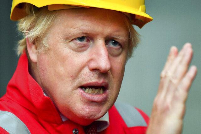 Britain's Prime Minister Boris Johnson gestures, during his visit to Appledore Shipyard in Devon, England, Tuesday, Aug. 25, 2020.  (Ben Birchall/PA via AP)