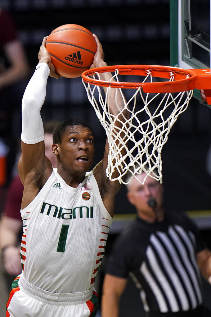 Miami forward Anthony Walker dunks during the first half of an NCAA college basketball game against Boston College, Friday, March 5, 2021, in Coral Gables, Fla. (AP Photo/Wilfredo Lee)