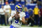 Los Angeles Rams quarterback Matthew Stafford (9) throws during the first half of an NFL football game against the Indianapolis Colts, Sunday, Sept. 19, 2021, in Indianapolis. (AP Photo/Michael Conroy)