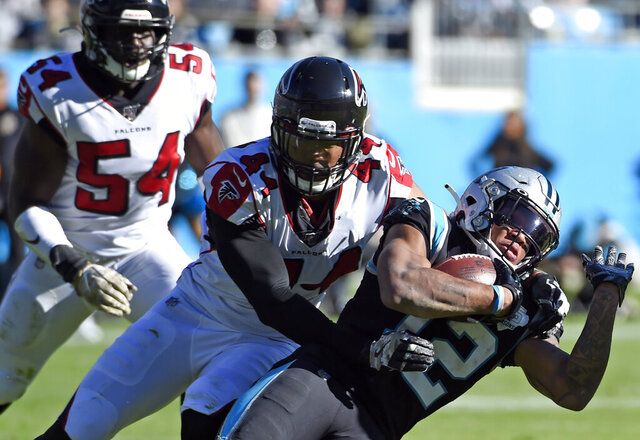 FILE - Atlanta Falcons defensive end Vic Beasley (44) tackles Carolina Panthers wide receiver D.J. Moore (12) during the first half of an NFL football game in Charlotte, N.C. The division that led the AFC in sacks in 2019 might be even tougher to block next season. Every team in the AFC South made at least one major move along the defensive front between free agency and the draft. Tennessee signed 2016 NFL sack leader Beasley in free agency. (AP Photo/Mike McCarn, File)