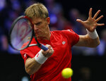 Team World's Kevin Anderson hits a return to Team Europe's Alexander Zverev during a men's singles tennis match at the Laver Cup, Sunday, Sept. 23, 2018, in Chicago. (AP Photo/Jim Young)