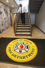 "In this Sept. 11, 2019, photo, Akron Fire Chief Clarence Tucker comes down the stairs at Fire Station No. 4, in Akron, Ohio. ""You can get a call someone has overdosed and you get there, you can bring them back with Narcan. Then you'll go to the same address in the afternoon,"" Tucker said. ""Or you go to that address in the morning and the two parents have overdosed and there's a child there. It's just horrible. It really is."" (AP Photo/Keith Srakocic)"