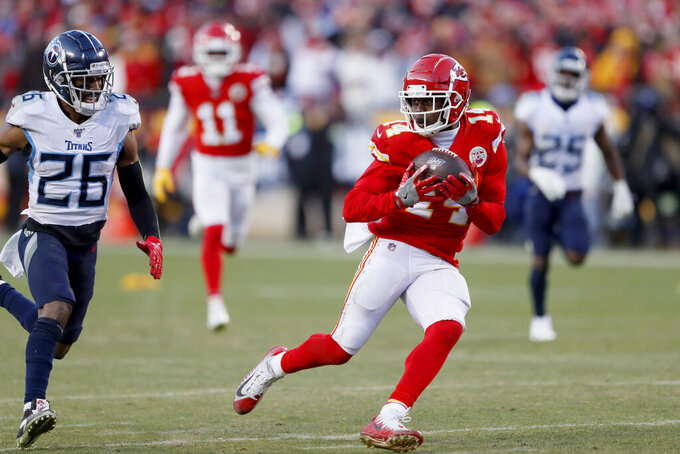 Kansas City Chiefs' Sammy Watkins (14) catches a touchdown pass against Tennessee Titans cornerback Logan Ryan (26) during the second half of the NFL AFC Championship football game Sunday, Jan. 19, 2020, in Kansas City, MO. (AP Photo/Charlie Neibergall)