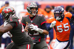 Tampa Bay Buccaneers quarterback Tom Brady, center, looks to throw a pass during the first half of an NFL football game against the Denver Broncos, Sunday, Sept. 27, 2020, in Denver. (AP Photo/David Zalubowski)