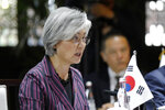 South Korean Foreign Minister Kang Kyung-wha, center, speaks with her Japanese counterpart Taro Kono and Chinese counterpart Wang Yi during their trilateral meeting at Gubei Town in Beijing Wednesday, Aug. 21, 2019. (Wu Hong/Pool Photo via AP)
